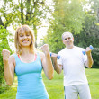 Personal trainer with client exercising — Stock Photo #27910727