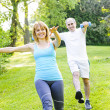 Personal trainer with client exercising in park — Stock Photo #27910823