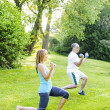 Stock Photo: Personal trainer with client exercising outside