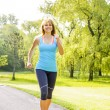 Woman running in park — Stock Photo
