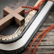 Stock Photo: Cross on Bible