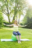 Woman on yoga balance ball — Stock Photo