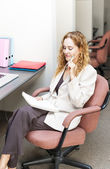 Business woman thinking at office desk — Stock Photo