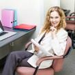 Foto Stock: Business womthinking at office desk