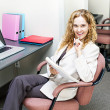 Стоковое фото: Business womthinking at office desk
