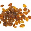 Pile of yellow sultana raisins on white — Stock Photo