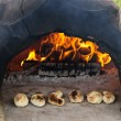 Stone wood oven baking bread — Stock Photo