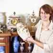 Woman with antique collection — 图库照片