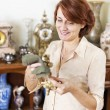 Woman polishing antiques — Stock Photo #29583673