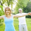 Personal trainer with client exercising outside — Stock Photo #29583927