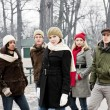 Group of young friends outside in winter — Stock Photo