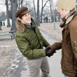 Two men shaking hands in park — Stock Photo