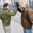 Two men doing high five in park — Stock Photo