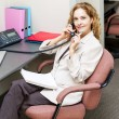 Stock Photo: Businesswomon telephone at office desk