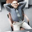 Man sitting at office desk — Stock Photo