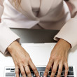 hands typing on laptop keyboard — Stock Photo
