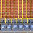 Stock Photo: Gas meters on brick wall