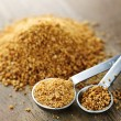 Coconut palm sugar in measuring spoons — Stock Photo #29586671