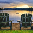 Stock Photo: Wooden chairs at sunset on beach