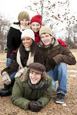 Group of friends outside in winter — Stock Photo