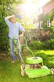 Man mowing lawn — Стоковое фото