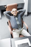 Man sitting at office desk — Foto Stock