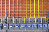 Gas meters on brick wall — Stock Photo