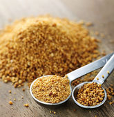 Coconut palm sugar in measuring spoons — Stock Photo