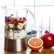 Stock Photo: Preparing smoothies with fruit and yogurt