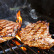 Stock Photo: Steaks on barbecue