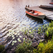 Stock Photo: Rowboat at lake shore at sunrise