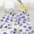 Stock Photo: Making candied violets