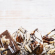 Chocolate bark on wood background — Stock Photo