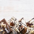 Chocolate bark on wood background — Stock Photo #39354511