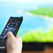 Hand with television remote control — Stock Photo