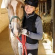 Stock Photo: Rider with horse in stable