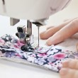 Hands with sewing machine — Stock Photo