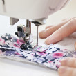 Stock Photo: Hands with sewing machine