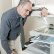 Stock Photo: Mhaving problem with photocopier in office
