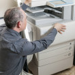 Stock Photo: Mopening photocopier in office
