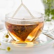 Herbal tea in glass cup — Stock Photo #39358715