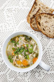 Cup of chicken soup — Stock Photo