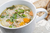 Cup of chicken rise soup — Stock Photo