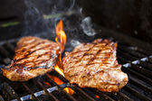 Steaks on barbecue — 图库照片