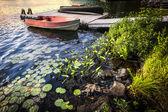 Rowboat at lake shore at dusk — Stock Photo