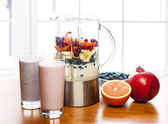 Making smoothies in blender with fruit and yogurt — Stock Photo