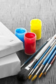 Paintbrushes with canvas — Stock Photo