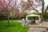 Backyard with gazebo and deck — Stock Photo