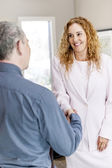 Man and woman shaking hands in office — Stock Photo