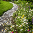 Wildflower garden and path to gazebo — Stock Photo